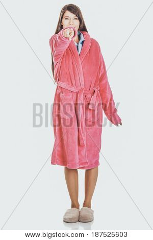 Woman in pink bathrobe pointing on you.