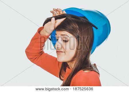 Woman holding empty plastic bucket.