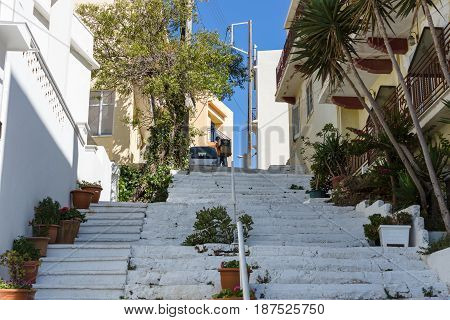 CRETE GREECE - JULY 11 2016: The narrow streets of a coastal elite tourist town Agios Nikolaos on the Greek island of Crete.