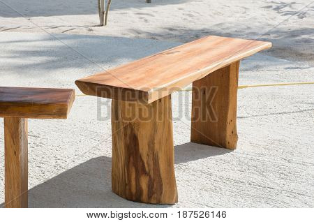 Soft focused picture of Wooden bench in sunlight