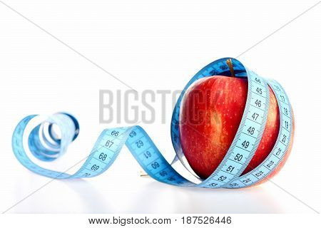 Apple In Red Colour Wrapped Around With Blue Measuring Tape