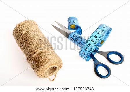 Coil Of Twine Thread Lying Near Metal Scissors