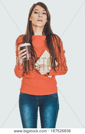 Young woman with coffee and notebook.