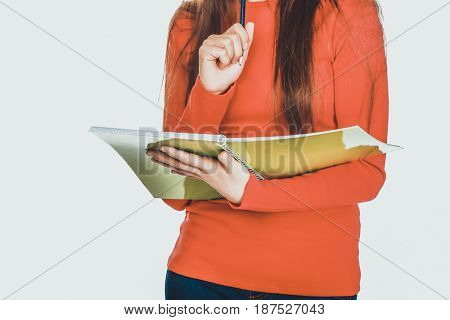 Student woman holding note and pen.