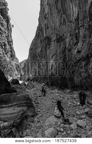 CRETE GREECE - JULY 14 2016: Samaria Gorge - a major tourist attraction of the island. Black and white.