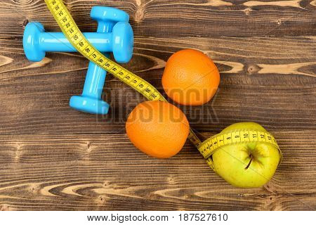 Exercise Concept, Dumbbells Weight With Measuring Tape, Orange And Apple