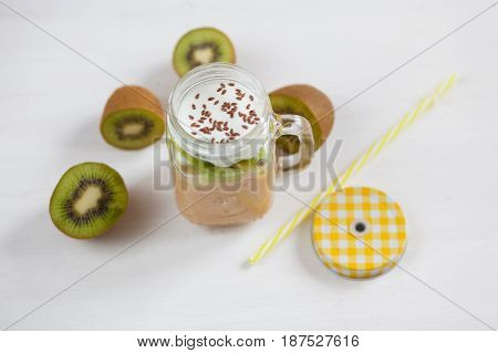Fresh Healthy Fruit Smoothies From Kiwi, Banana, Pear And Apple In A Jar On A White Background. Soft