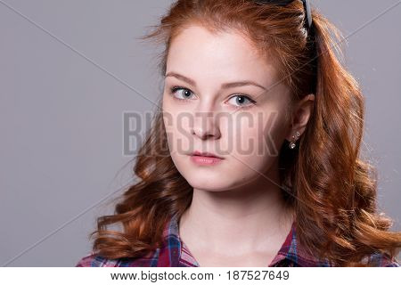 Close-up Portrait Of A Red-haired Beautiful Woman