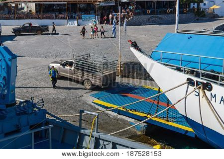 CRETE GREECE - JULY 14 2016: Ferry at the pier. Agia Roumeli village Chania region of Crete. Agia Roumeli is accessible only by foot or by sea (ferry).