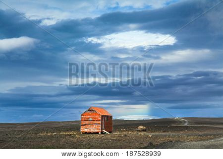 Panoramic View Of Barren Landscape With Old Red Snowstorm Shelter At Kjolur Highland Road, Iceland