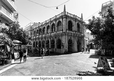 HERAKLION GREECE - JULY 16 2016: The Heraklion Town Hall. Built in the 17th century as Venetian armoury. The Ottomans also used it as a treasury for the island's taxes. Rebuilt in 1962. Black and white.