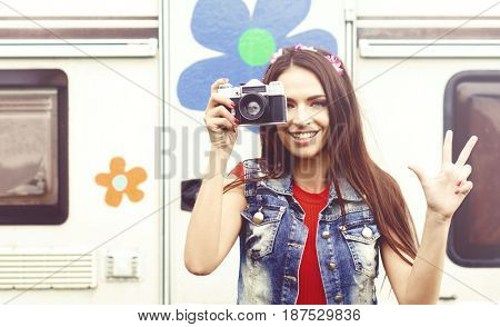 Young, beautiful hipster girl with vintage camera outdoors at summer. Vacation, holiday, concept.