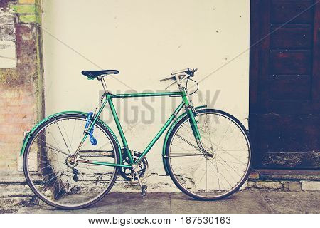Old Green Bicycle At The Wall
