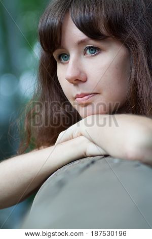 Cute thoughtful girl looking into the distance, portrait