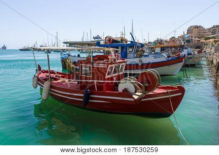 HERAKLION GREECE - JULY 16 2016: Crete. Moored fishing boats in the seaport.
