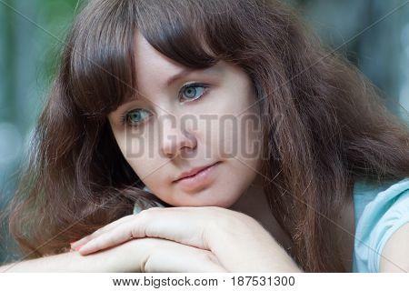 Lovely pensive girl dreams, looks sideways, portrait