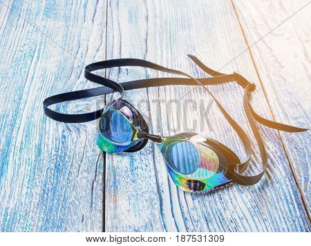 Accessories for sports swimming on wooden background sunshine