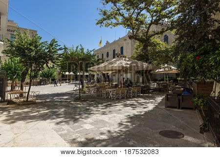 HERAKLION GREECE - JULY 16 2016: The tables cafes to the square in front of the Church of Saint Titus in the historic center of the city.