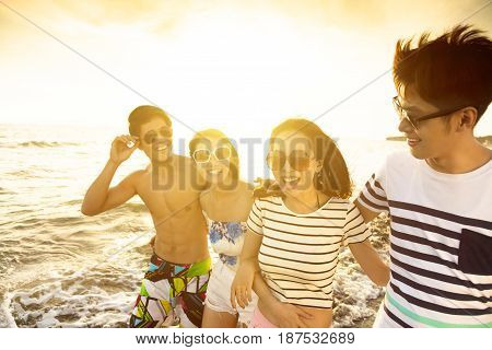 happy young group walking on the beach enjoy summer vacation