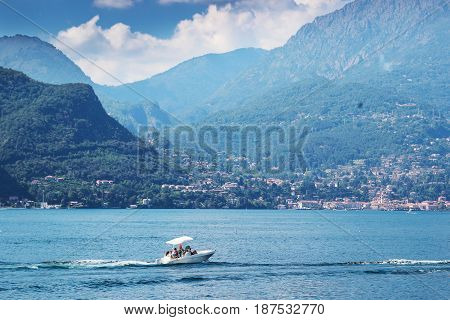 Blue Como lake in summer time Italy.