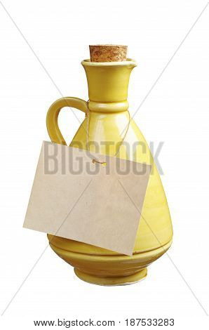 Ceramic jug and blank label isolated on white background