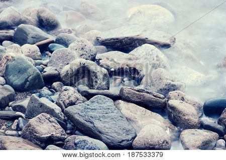 Stones at sea shoreline. Color filtered imaged.