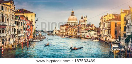Panoramic View Of Famous Canal Grande And Basilica Di Santa Maria Della Salute At Sunset In Venice,