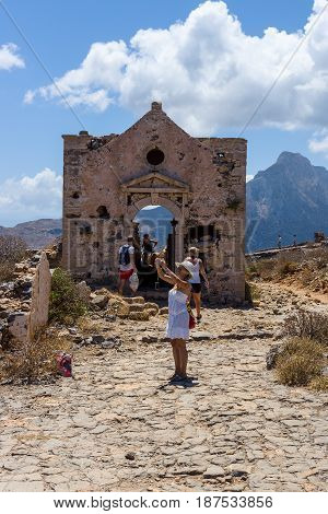 CRETE GREECE - JULY 18 2016: The ruins of a Christian church in the territory of the ancient Venetian fortress on the island Imeri Gramvousa. Mediterranean Sea.