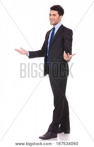 full body picture of an excited businessman welcoming on white background