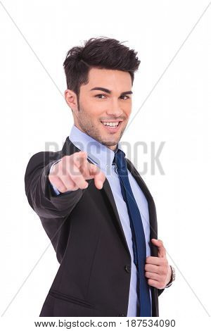 smiling businessman pointing his finger to the camera on white background