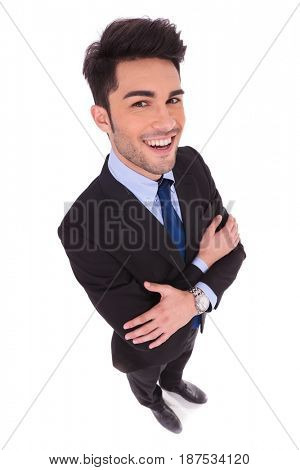 wide angle picture of a smiling businessman with hands crossed on white background