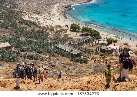 CRETE GREECE - JULY 18 2016: The descent of tourists from the ancient Venetian fortress. The island Imeri Gramvousa. Mediterranean Sea.