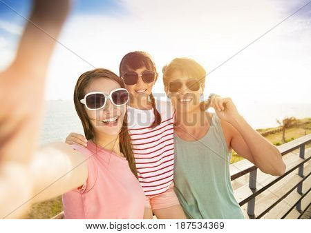 happy family taking selfie on summer vacation