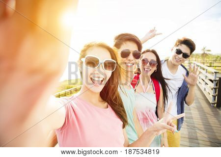 happy young group friends taking selfie on summer vacation