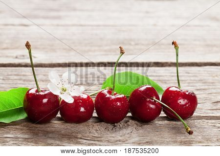 Fresh garden cherry on wooden table. With copy space