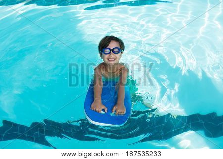 Portrait of smiling boy swimming in the pool at the leisure center