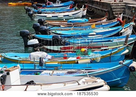 Blue Boats In The Harbor