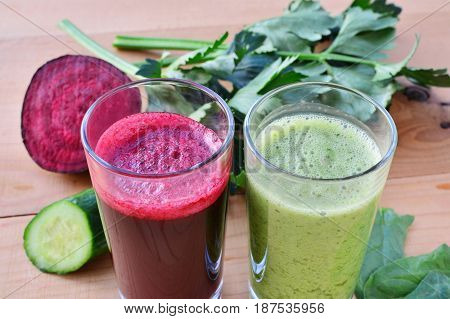 Healthy vegetable juice beet and green smoothie in glasses.