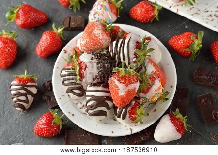 Strawberries covered with chocolate on a gray background