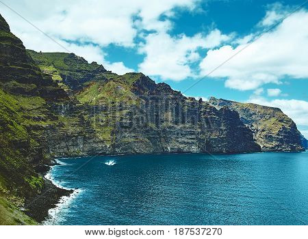 Beautiful View From The Ocean To Mountain Forest With Blue Sky And Clouds