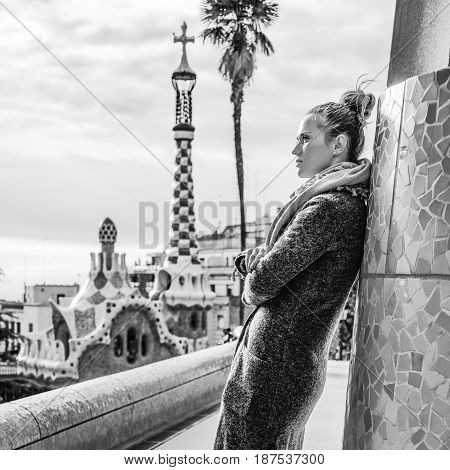 Modern Tourist Woman Standing At Guell Park, Spain In Winter