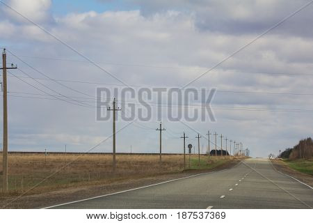 Road among fields - spring countryside in Russia, wide angle