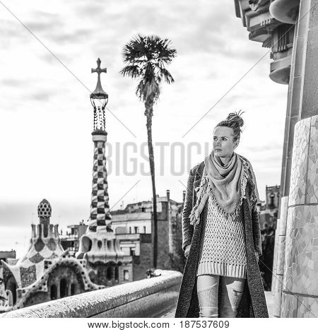 Tourist Woman At Guell Park In Barcelona Having Walking Tour