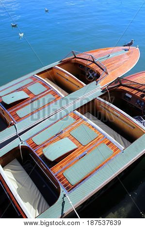 Two Classic Wooden Speedboats Moored In Blue Water Ready To Take Passengers On An Ocean Trip