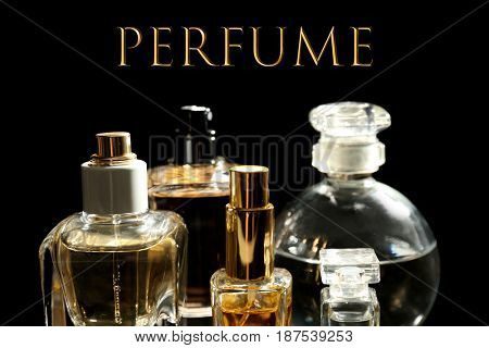 Bottles of perfume and text on black background