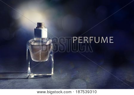 Bottle of perfume and text on blurred background