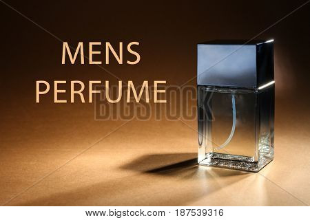 Men's perfume. Bottle of cologne and text on color background
