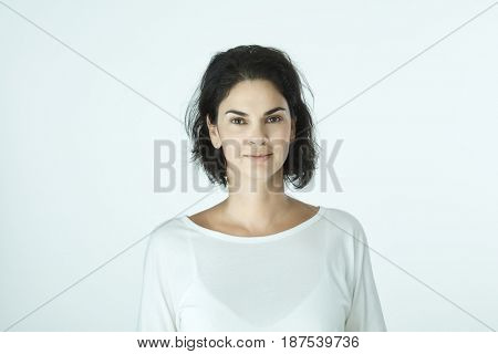 Portrait of casual smiling adult woman on white background.