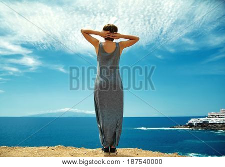 Girl Woman In Casual Hipster Clothes Standing On The Cliff Of Mountain