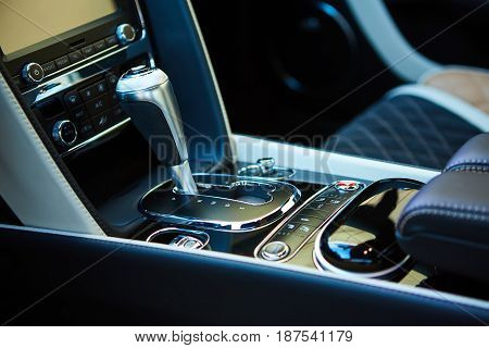 Detail of modern car interior, gear stick